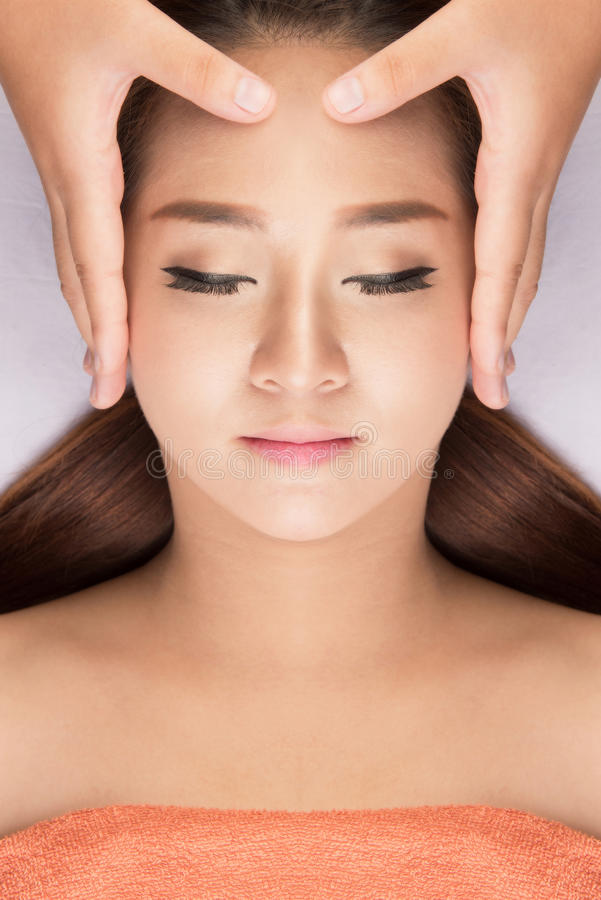 Asian Woman having spa massage of the head stock images