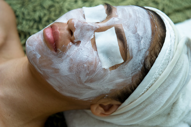 Asian woman having traditional facial spa royalty free stock photos