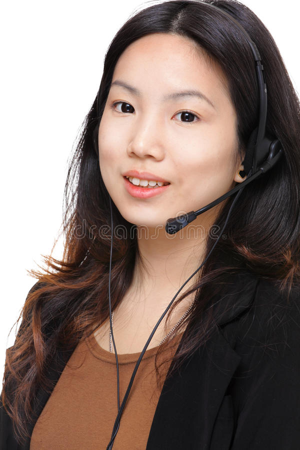 Asian woman with headset. Over white background royalty free stock photos