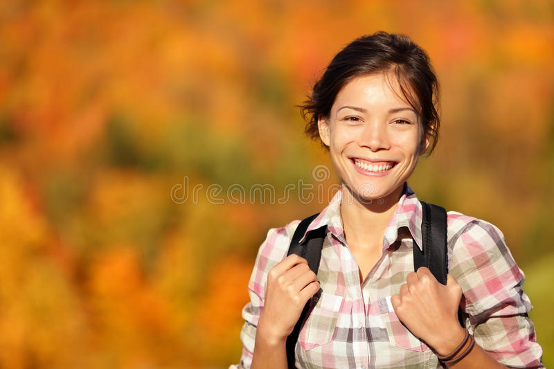 Asian woman hiker hiking in Autumn forest