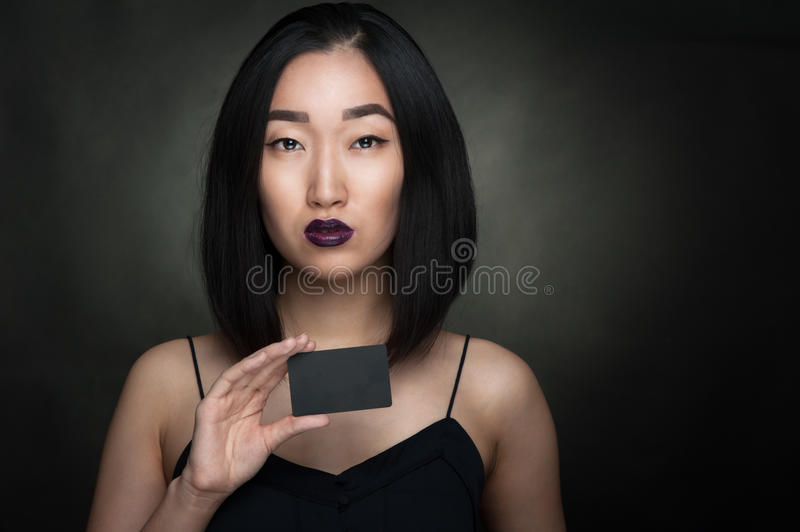 Asian woman hold card stock image