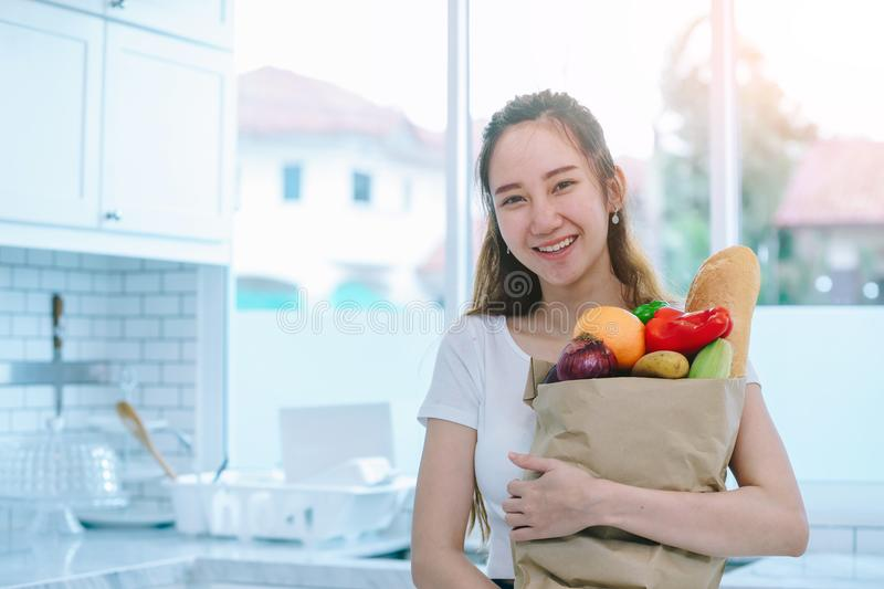 Asian woman holding the fruits royalty free stock images