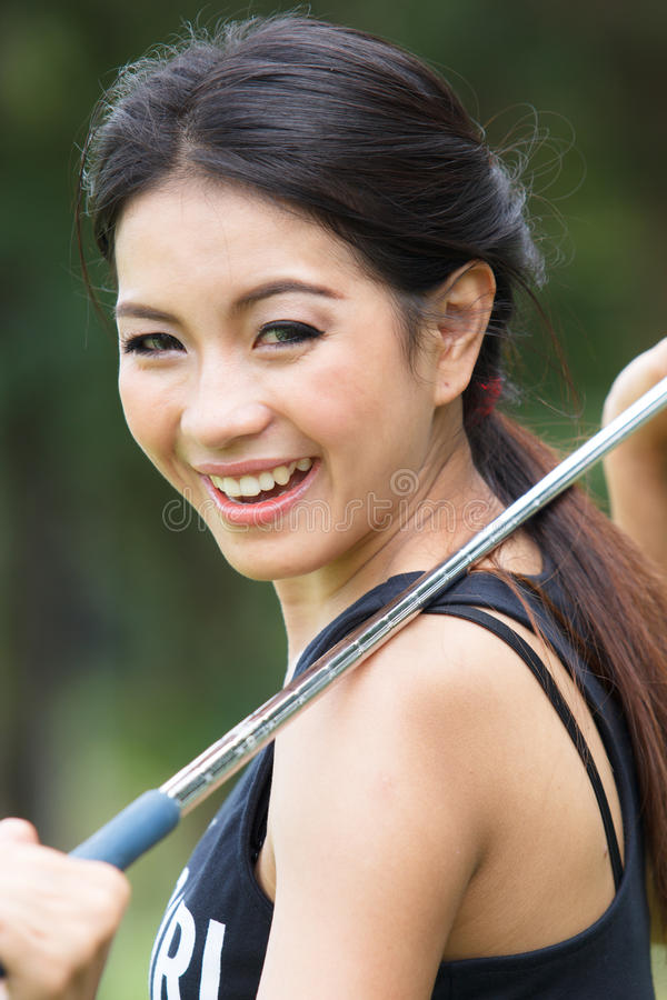 Asian woman holding a golf. Portrait of Asia woman an elegant woman playing golf stock photo
