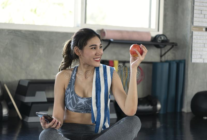 Asian woman holding red apple for eating healthy. diet health lifestyle concept stock photo