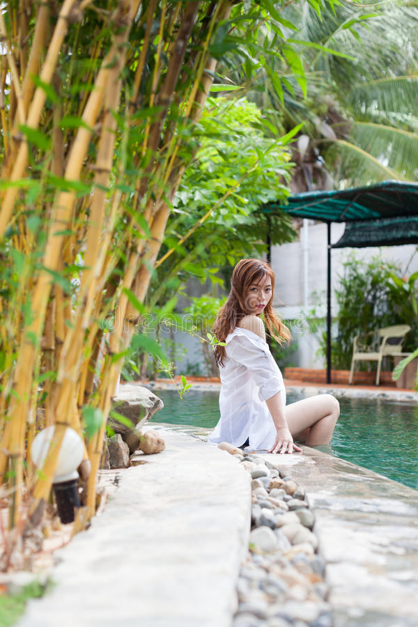 Asian Woman In Hotel Swimming Pool Relaxing Vacation Travel, Young Girl Enjoying Spa. Exotic Paradise Resort royalty free stock images
