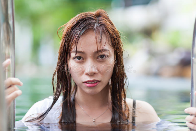Asian Woman In Hotel Swimming Pool Relaxing Vacation Travel, Young Girl Enjoying Spa. Exotic Paradise Resort stock photography