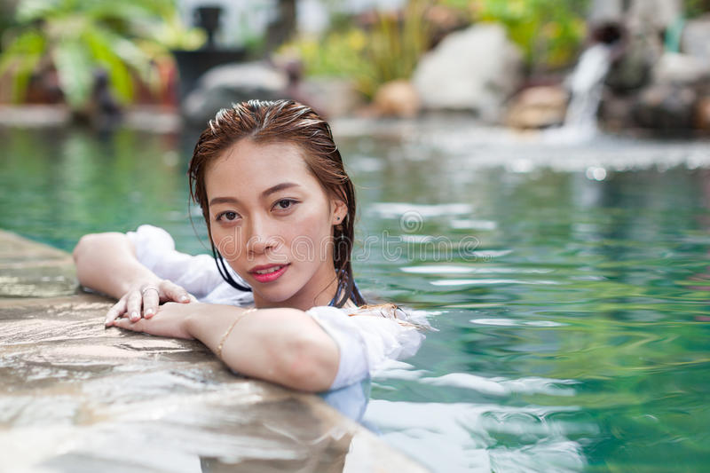 Asian Woman In Hotel Swimming Pool Relaxing Vacation Travel, Young Girl Enjoying Spa. Exotic Paradise Resort stock images