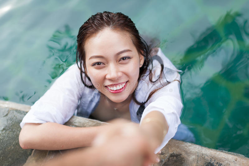 Asian Woman In Hotel Swimming Pool Relaxing Vacation Travel, Young Girl Enjoying Spa. Exotic Paradise Resort royalty free stock image