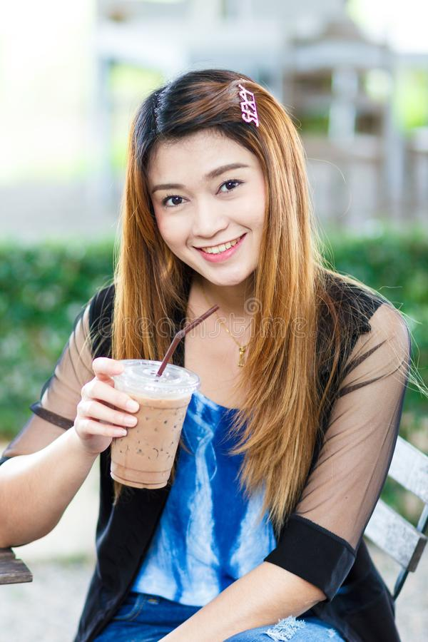 Asian woman with coffee royalty free stock photos