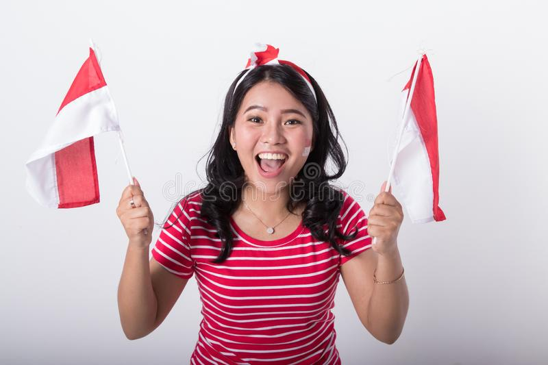 Asian woman with indonesian flag royalty free stock photography