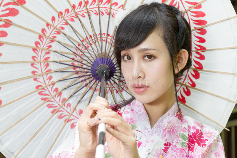 Asian woman in kimono holding umbrella royalty free stock images