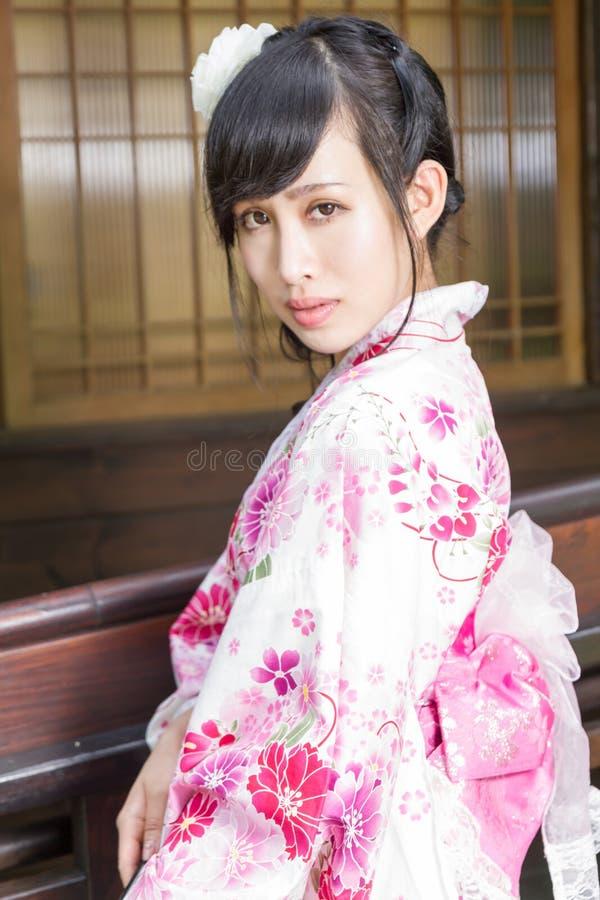 Asian woman in kimono holding umbrella royalty free stock photo