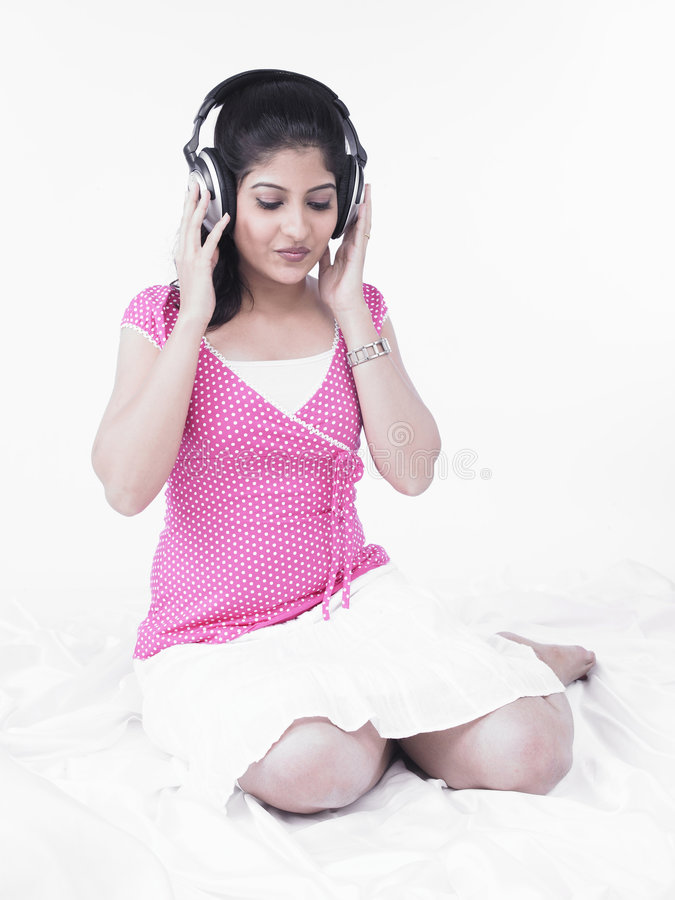 Download Asian Woman Listening To Music Stock Image - Image: 7386423