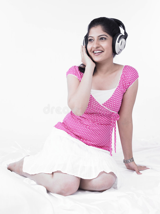 Download Asian Woman Listening To Music Royalty Free Stock Photo - Image: 7386435