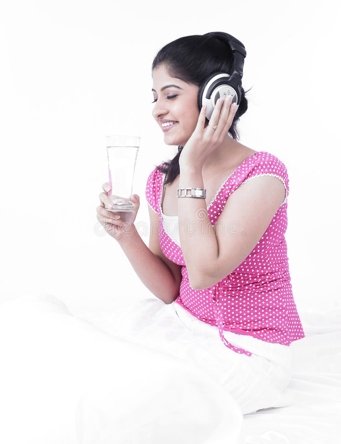 Download Asian Woman Listening To Music Stock Photo - Image: 7386452