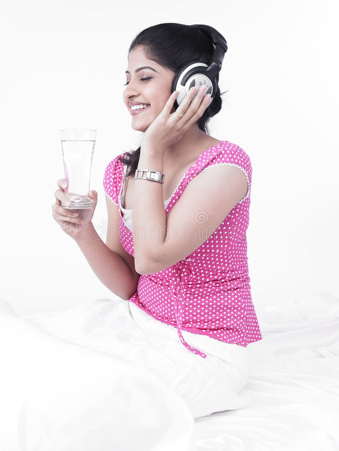 Asian Woman Listening To Music Stock Images