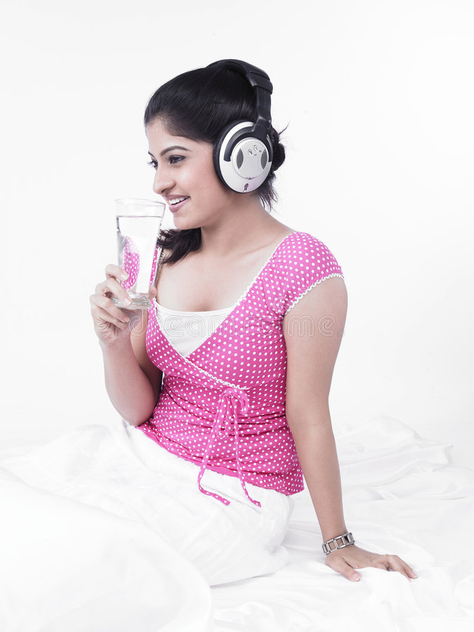 Download Asian Woman Listening To Music Stock Image - Image: 7386497