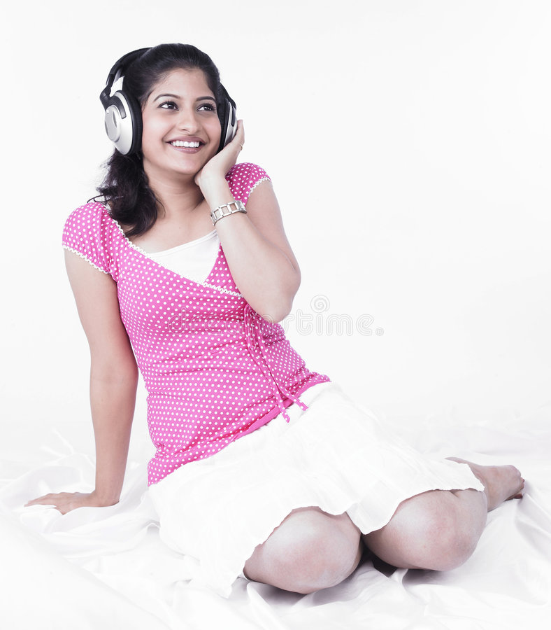 Download Asian Woman Listening To Music Stock Image - Image: 7387599