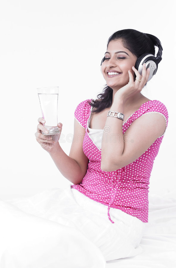 Download Asian Woman Listening To Music Stock Image - Image: 7387613