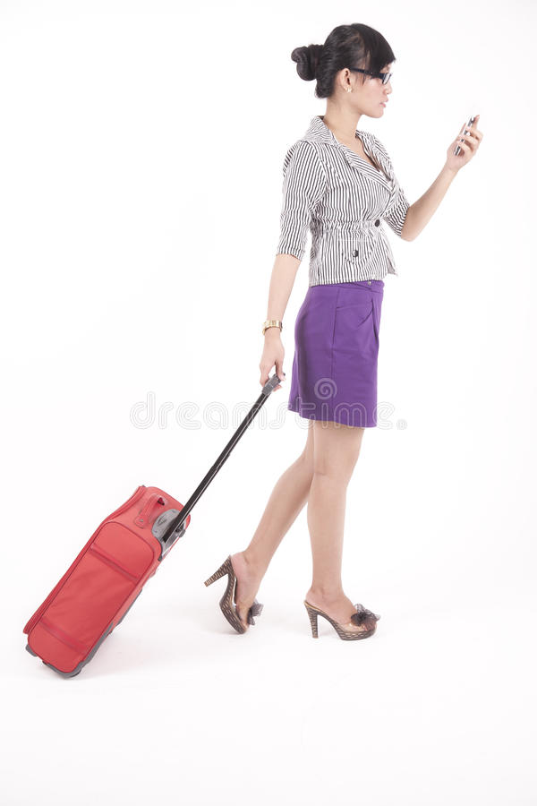 Asian Woman Looking At Her Cellphone Stock Images