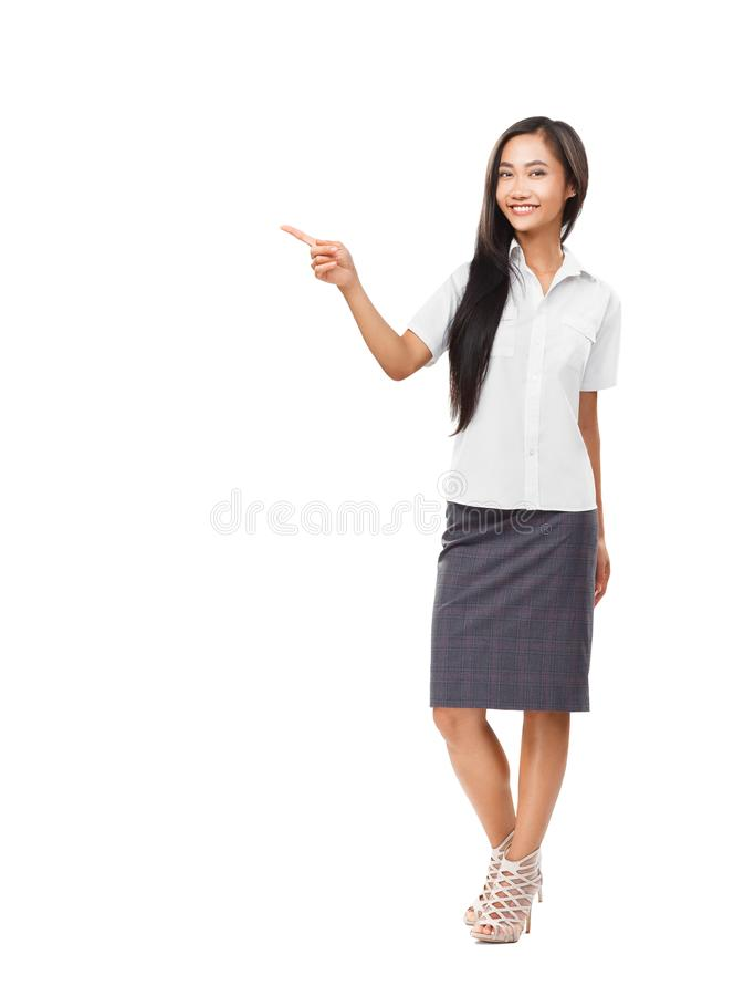 Asian woman looking and pointing finger to the side royalty free stock images