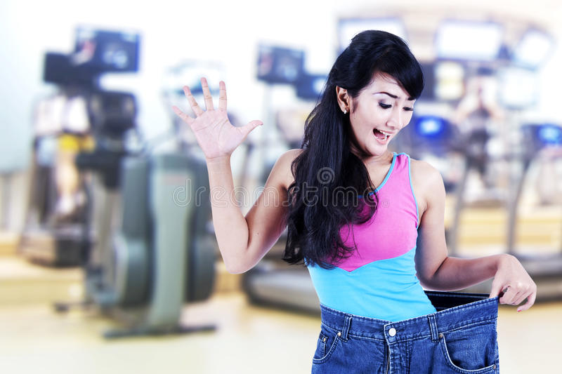 Download Asian woman loosing weight stock image. Image of pants - 26464839