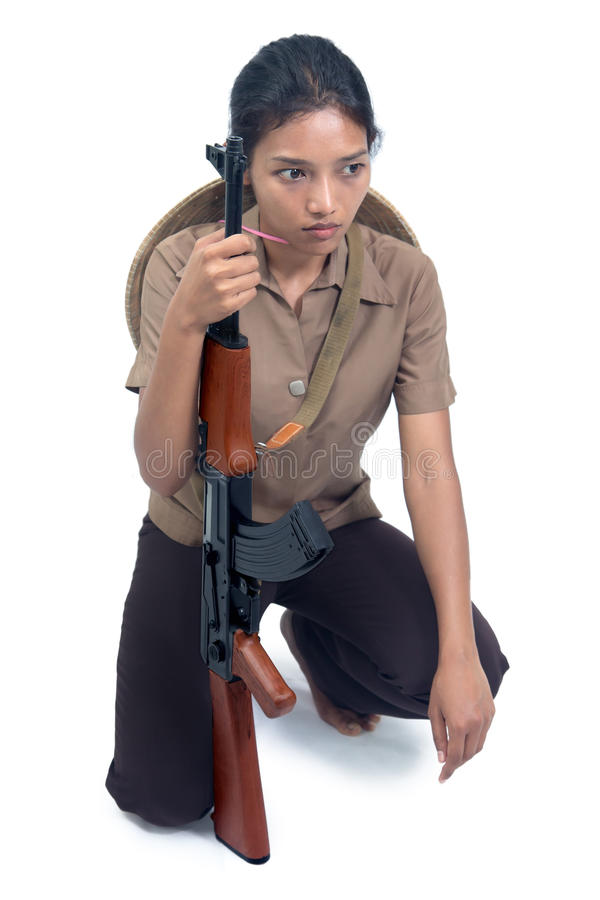 Asian woman with a machine gun royalty free stock images