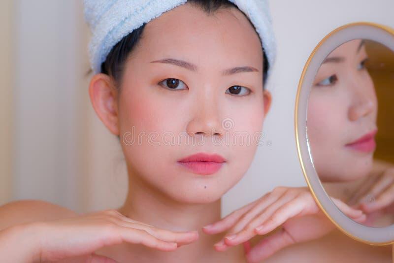 https://thumbs.dreamstime.com/b/asian-woman-makeup-lifestyle-portrait-young-beautiful-happy-korean-girl-towel-head-wrap-next-to-mirror-skin-care-220977718.jpg