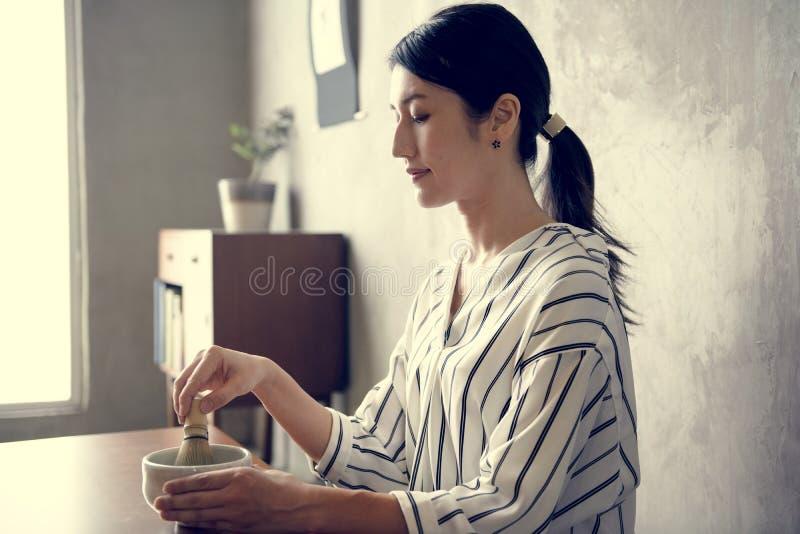 Asian woman making traditional Japanese tea at home royalty free stock photos