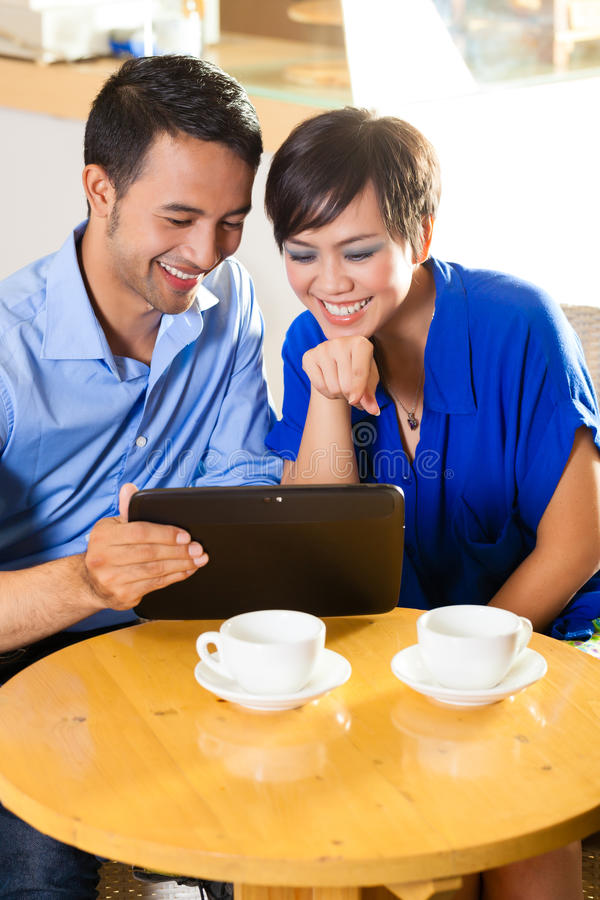Download Asian Woman And Man In An Coffee Shop Stock Image - Image of  pictures,