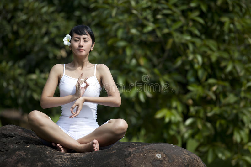 Asian Woman Meditating For Yoga Outside Royalty Free Stock Images