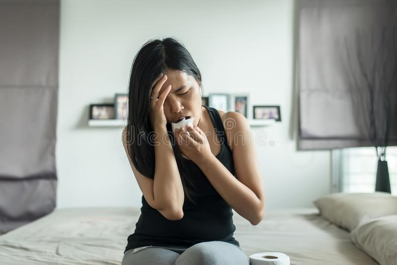 Asian woman with morning sickness,Pregnant female nausea in room. Asian woman with morning sickness,Pregnant female nausea in her room stock photography