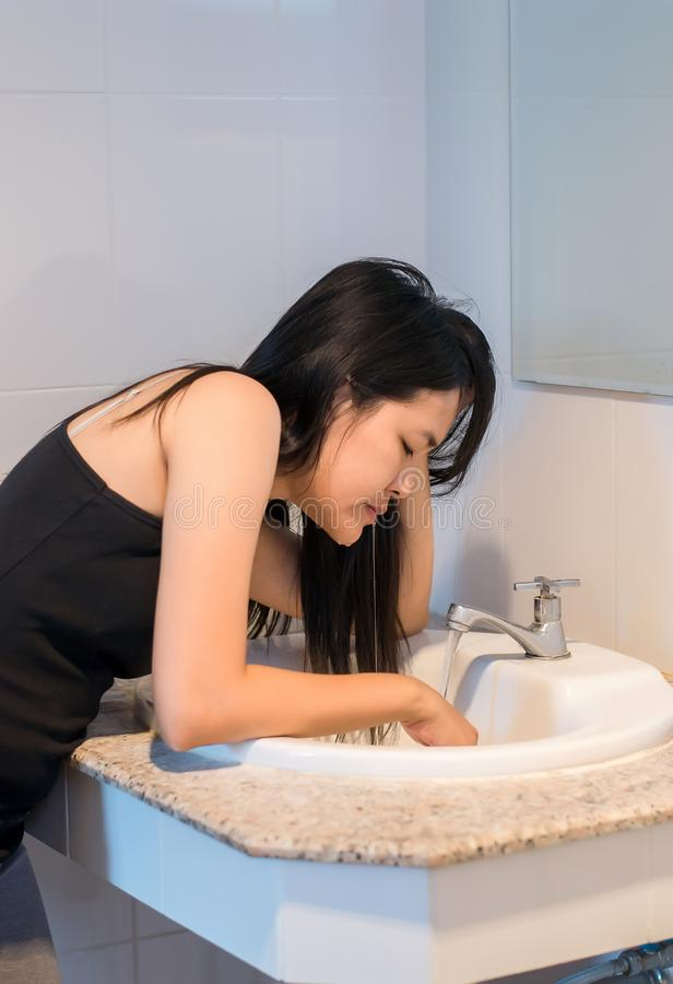 Asian woman with morning sickness,Pregnant female nausea into the toilet bowl. Asian woman with morning sickness,Pregnant female nausea into the toilet-bowl stock images