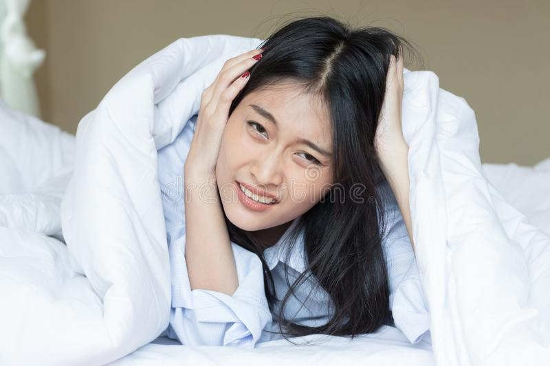 Asian woman is not happy to wake up royalty free stock photo