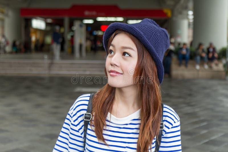 Asian woman outside subway station royalty free stock photo