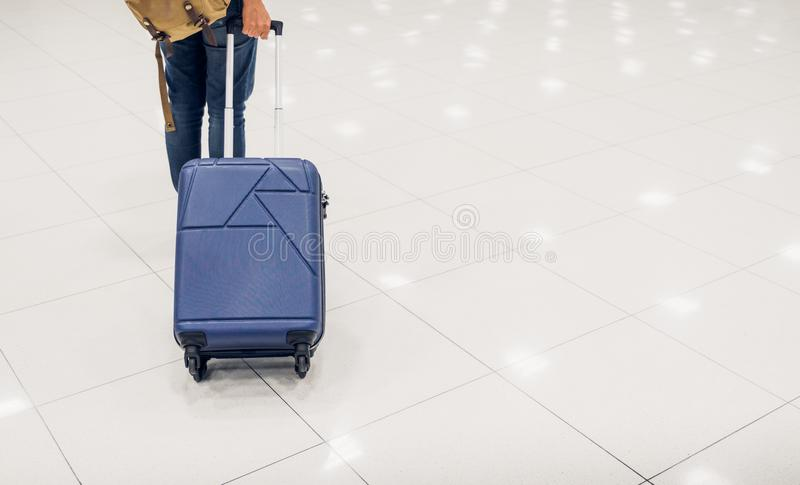 Asian woman passenger holding suitcase in airport terminal,travel concept. Asian woman passenger holding suitcase in airport terminal,travel concept royalty free stock photos