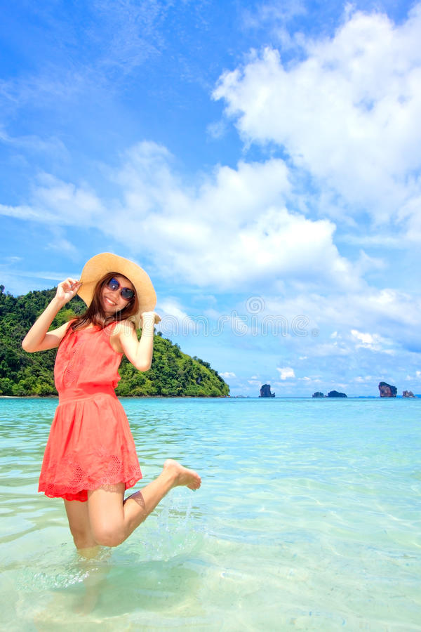Download Asian Woman In A Pink Dress Standing On The Beach Stock Photo - Image: 25856974