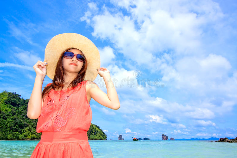 Asian Woman In A Pink Dress Standing On The Beach Royalty Free Stock Image