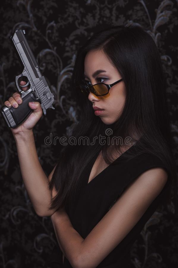 Asian woman with pistols stock photography