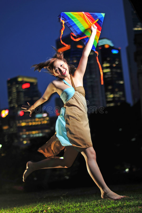 Asian Woman Playing Kite royalty free stock photography