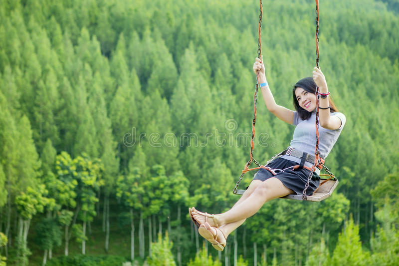 Asian woman playing on swing royalty free stock images