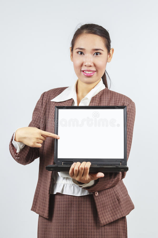 Asian Woman Pointing At Her Laptop Stock Images