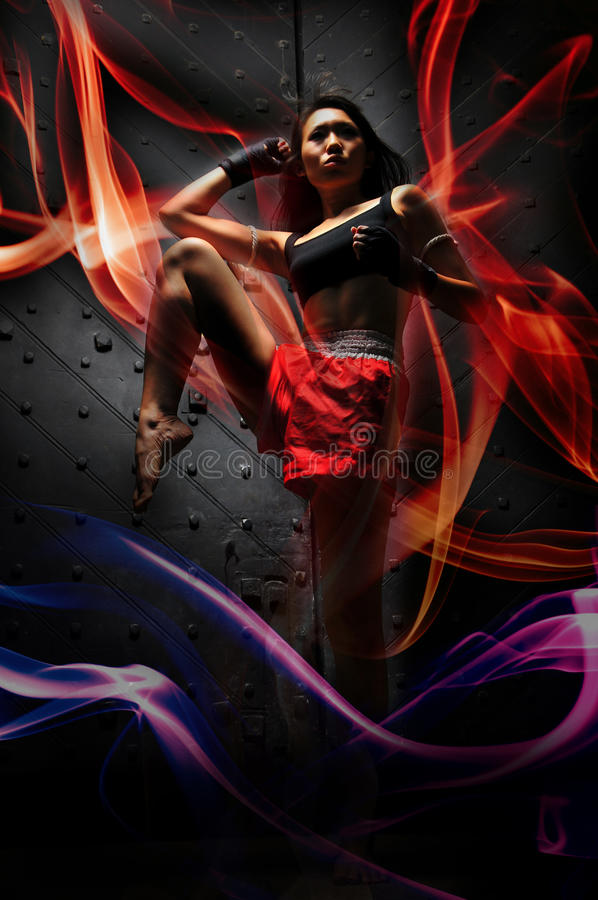 Asian Woman Practising Muay Thai special powers royalty free stock images