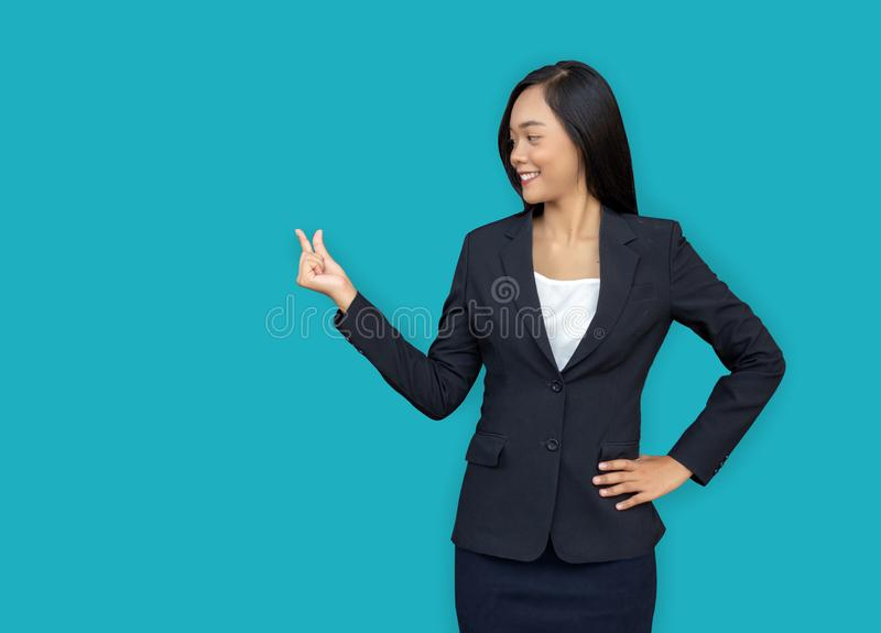 Asian woman present mini product on isolated background include clipping path. Pretty asian businesswoman open hand present mini product on fingle with blue royalty free stock image
