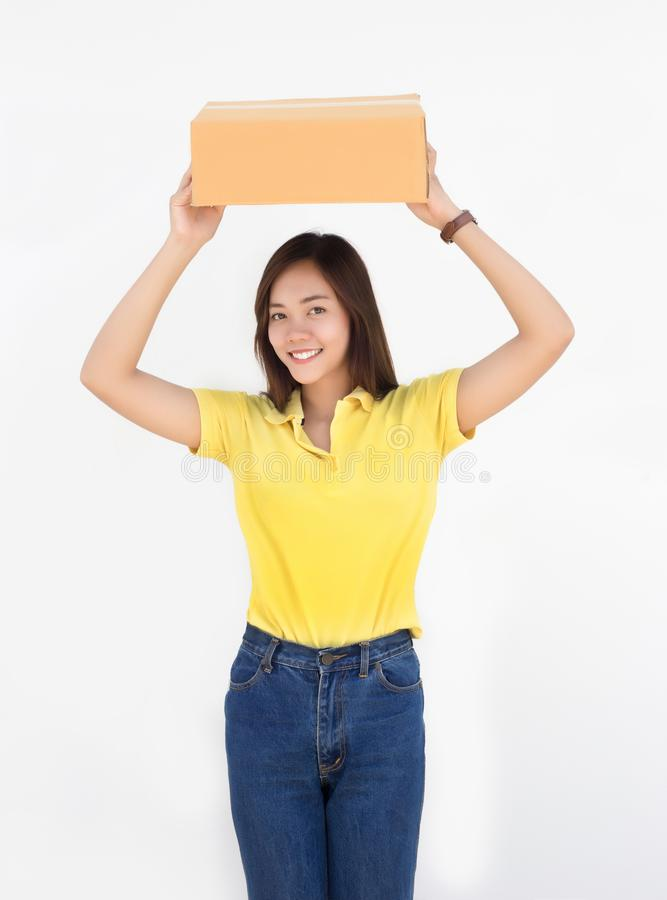 Asian woman put up paper packaging box delivery concept. royalty free stock photo