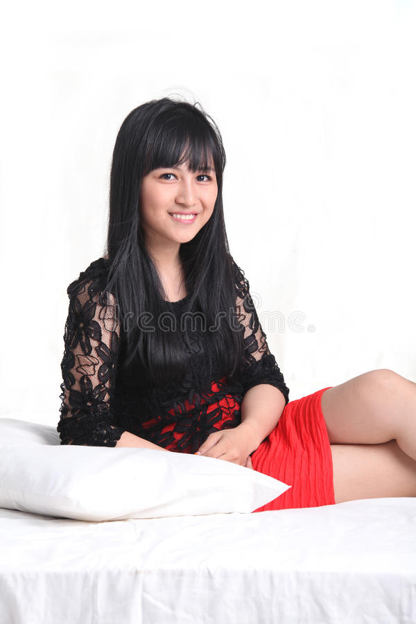 Asian Woman In Red Dress Stock Photo