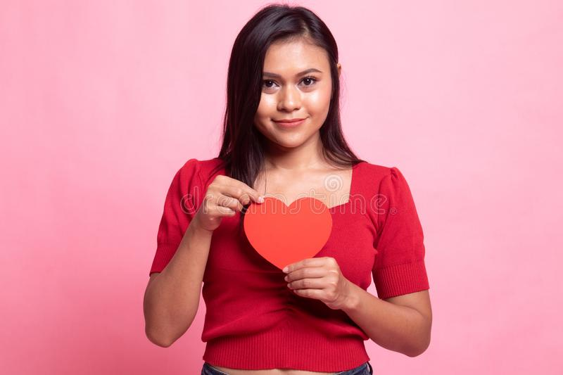 Asian woman with red heart. On pink background stock photo