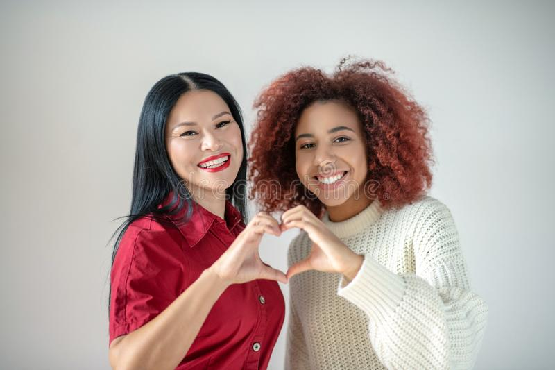 Asian woman with red lips standing near her best friends stock photos