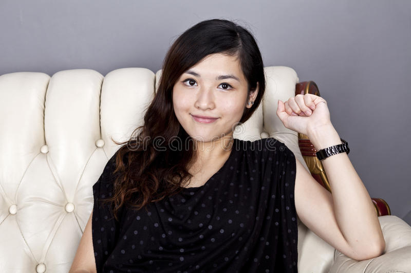 Asian woman relax on sofa royalty free stock image