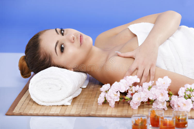 Asian woman relaxes at the spa. Beautiful Asian woman relaxes at the spa stock photo